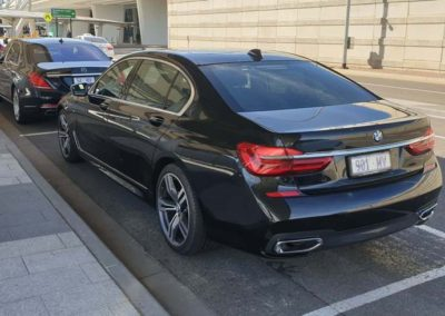 A black  BMW7 series, a Mercedes S class and a Mercedes Maybach hired for a group wine tour