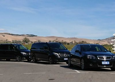 A limo sedan and two limousine  vans conducting a Barossa wine tour for overseas dignitaries